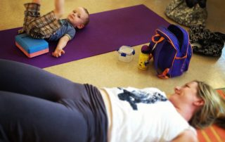 mother and child in yoga pose