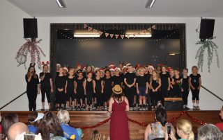 choir singing christmas songs on stage