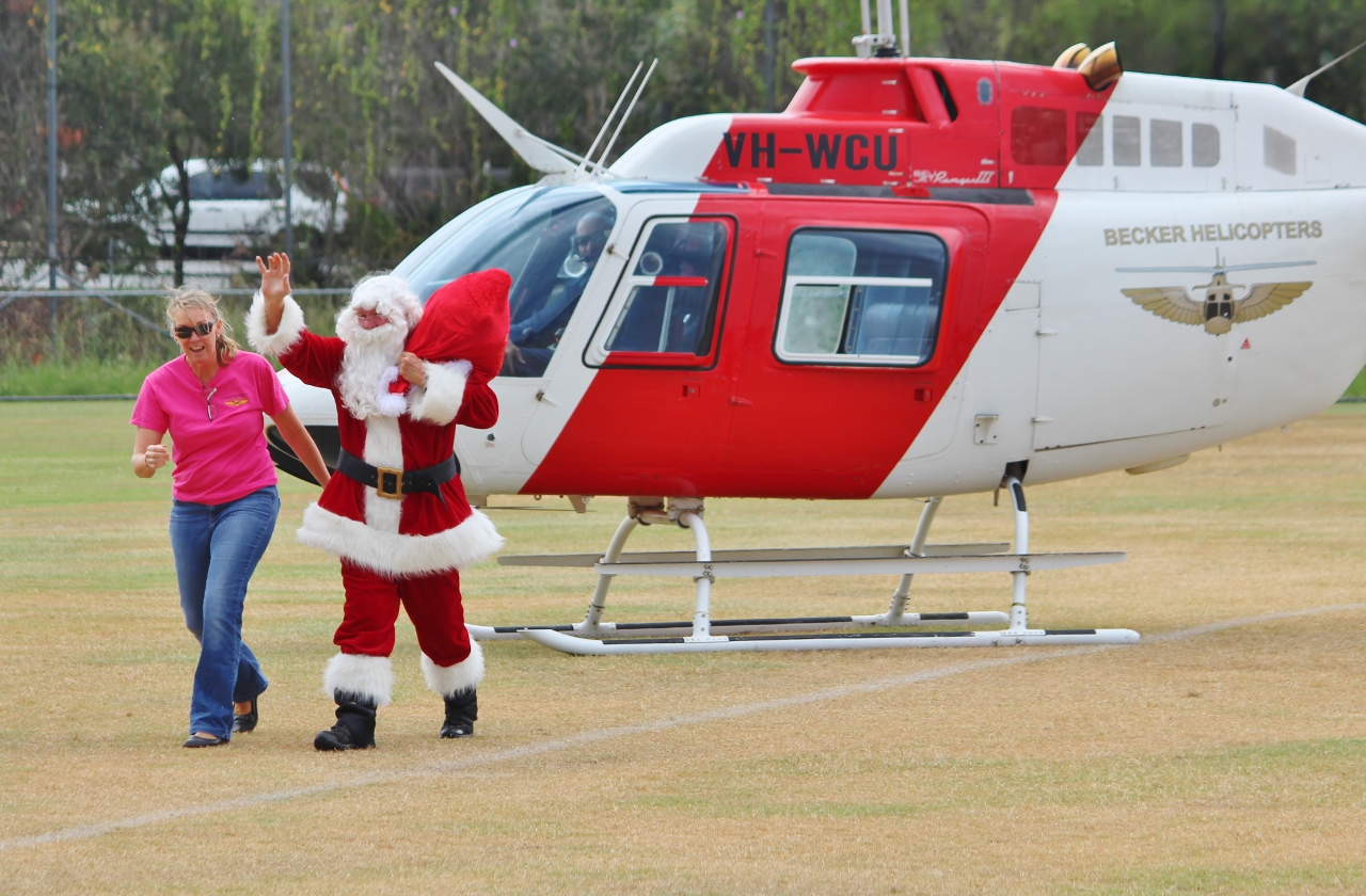 santa arriving by helicopter at north shore community centre